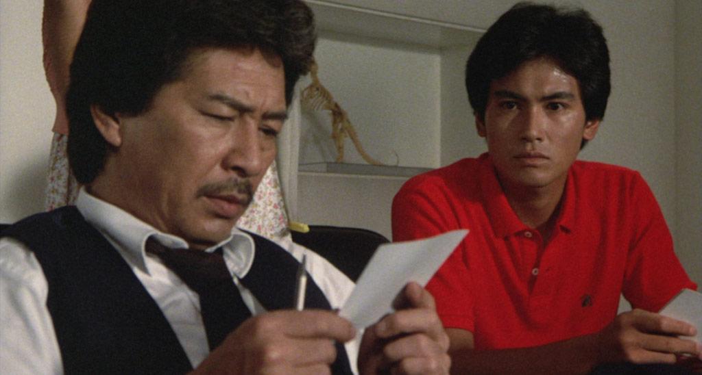 Yosuke Natsuki Examines a Photo